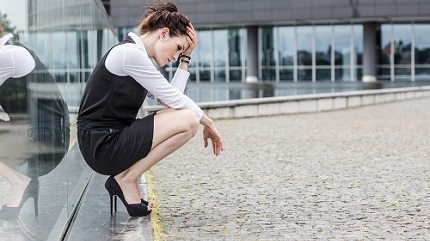 depressed-lady-at-work-crouched-by-window-shutterstock_169783319.jpg (1)
