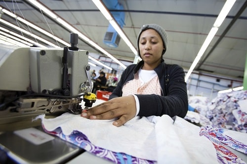 woman sewing in sweat shop in asia iStock_SMLL.jpg